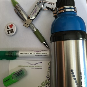 water bottle, USB carabiner, I heart TR pin, pen/highlighter, sticky pad, hand sanitizer, mini highlighter